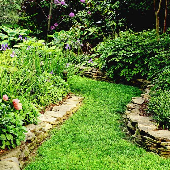 Grassy garden path between stone edging