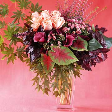 p60_65_Vase of flowers with dark pink background