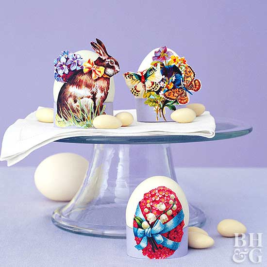 decorated Easter eggs on glass cake stand