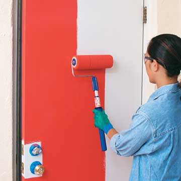 Roll paint on door with roller