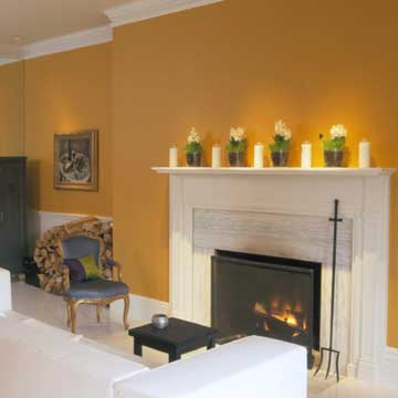 orange wall and white fireplace