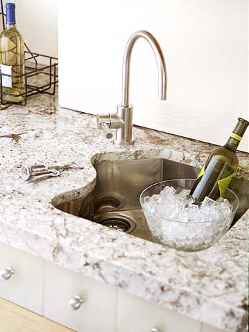 BHGMay05_ShowKitchen_Bottle Of Wine On Ice In Sink