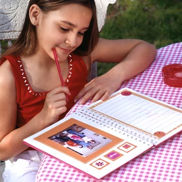 Girl Writing In Scrapbook