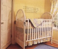 crib with yellow baby quilt over rail