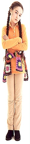 girl with braids & crocheted sweater tied around waist
