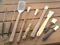 Long-handled tongs, basting brushes, and spatulas