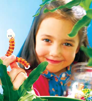 Girl with Homemade Caterpillars