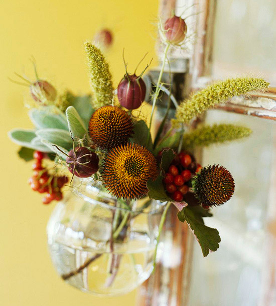 assorted plants and flowers in round vase