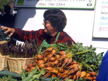 woman at veggie stand