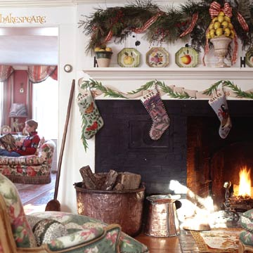 Decorated Fireplace Mantle With Old Time Stockings and Plates