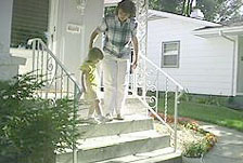 parent and child walking down steps