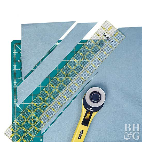 Blue cloth shown with sewing tools