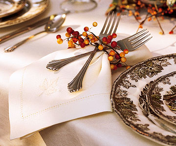 napkin with forks wrapped on with autumn berry ring