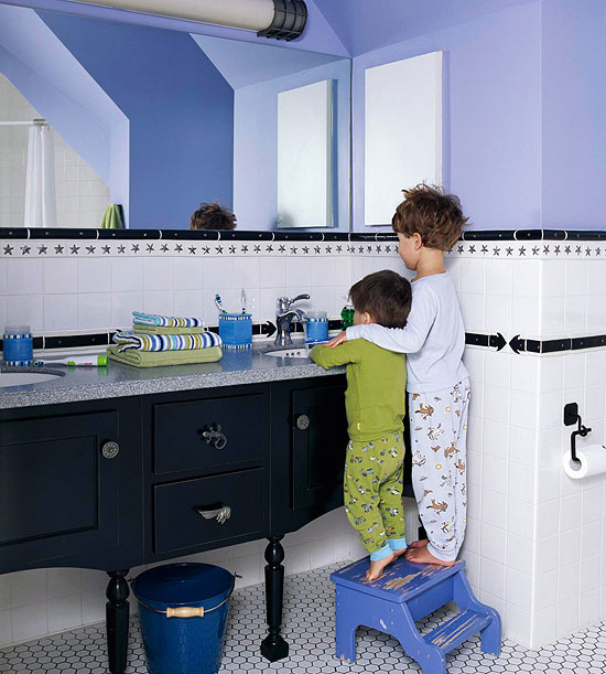 children brushing teeth at sink