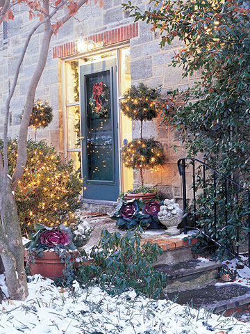 Front entrance with topiaries and white lights