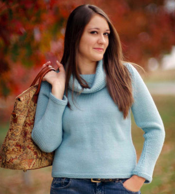 Woman wearing a blue cowl neck knitted sweater