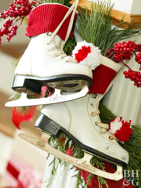 ice skates with berries and pine needles