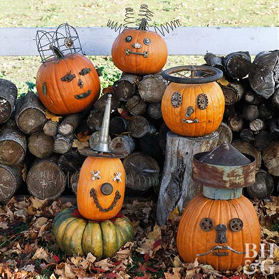 decorated pumpkins with faces make of metal junk pieces