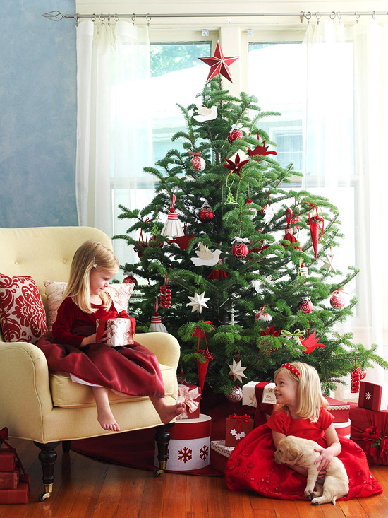 Traditional Christmas Tree with little girls