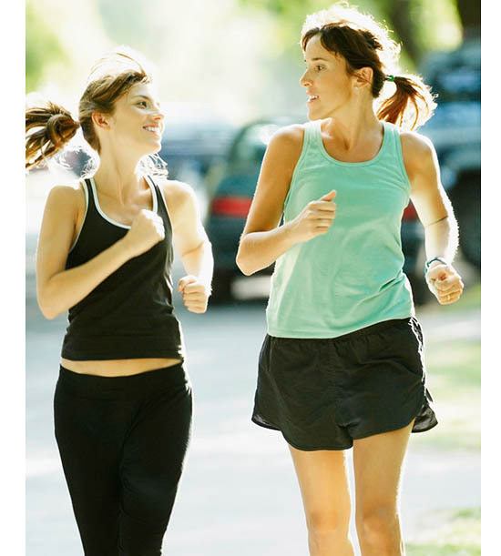 two woman jogging outside