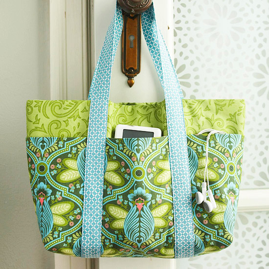 green and blue bag on doorknob