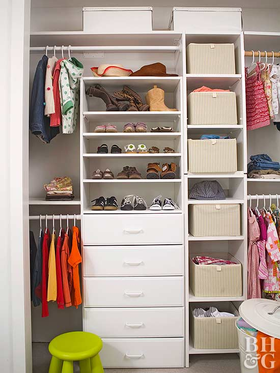kids closet with white shelves and baskets