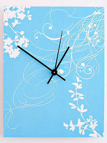 Decorative wall clock with scrapbook paper on face