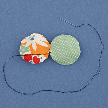 Fabric yo-yos stitched together