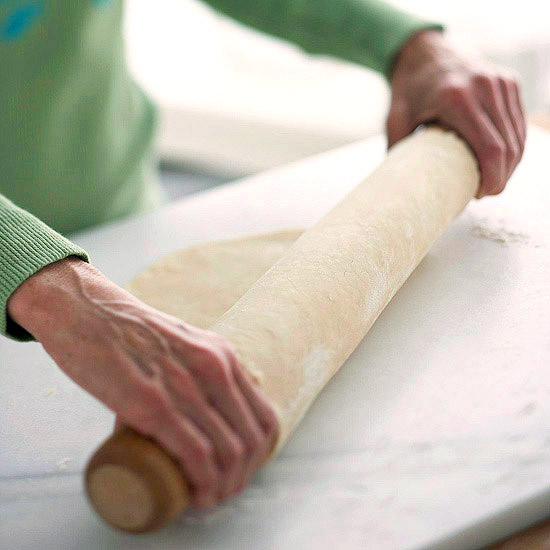 Wrapping dough around rolling pin to transfer to pie plate