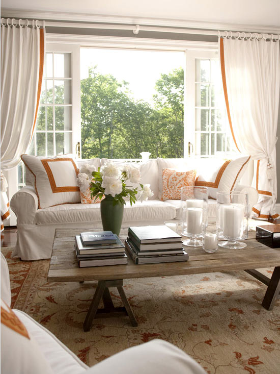 Neutral living room with orange graphic accents