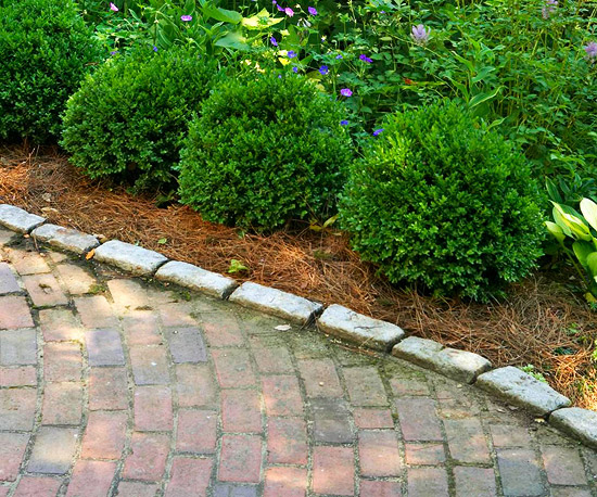 Using landscape edging better homes gardens for Alternative garden edging