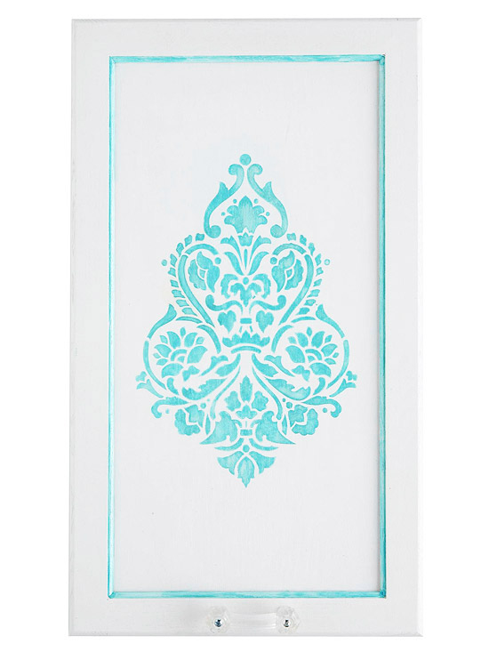 White door with teal stencil