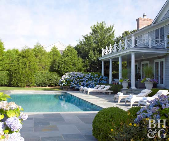 colonial style home with in ground pool