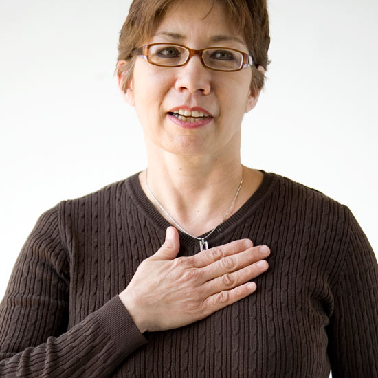 woman with hand on heart