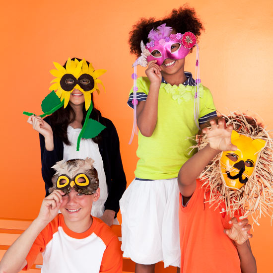 Four kids with Halloween masks