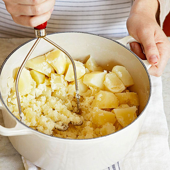 Mashing potatoes with a masher