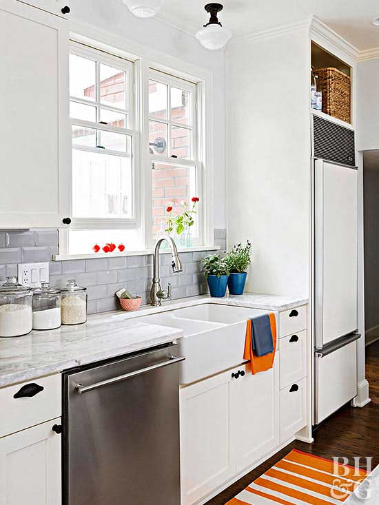 white kitchen with subway tile backsplash