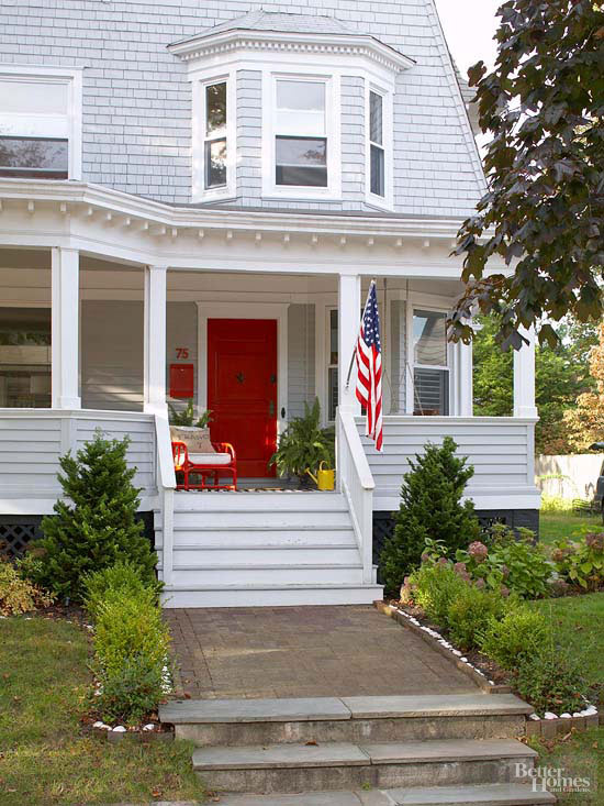Home with front porch and red door