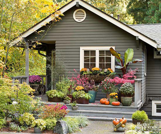 Home exterior with container garden on porch