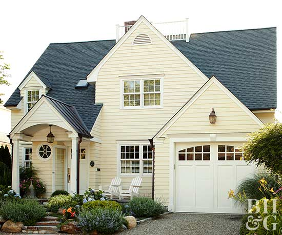 pale yellow exterior with landscaping