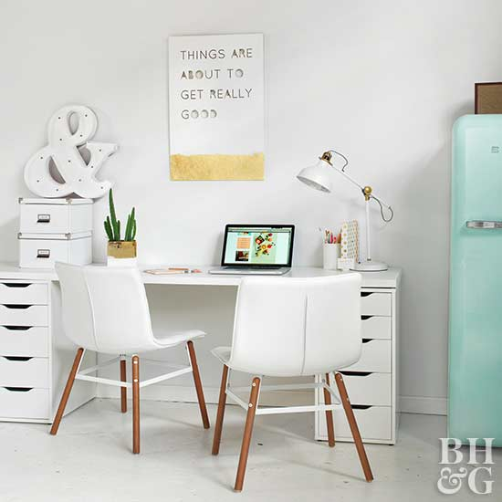 office with white table, white chairs, white desk lamp, wall art,