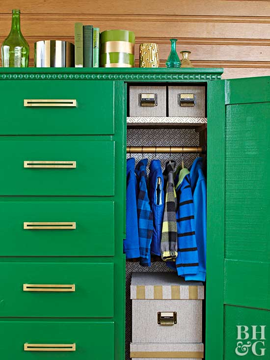 green armoire with gold handles