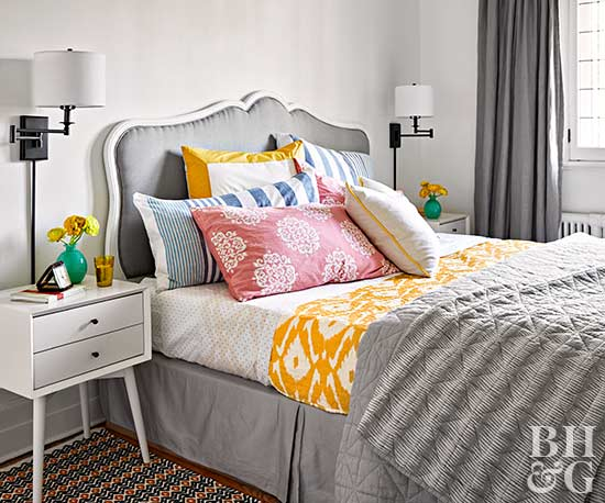gray bedroom with colorful accent pillows
