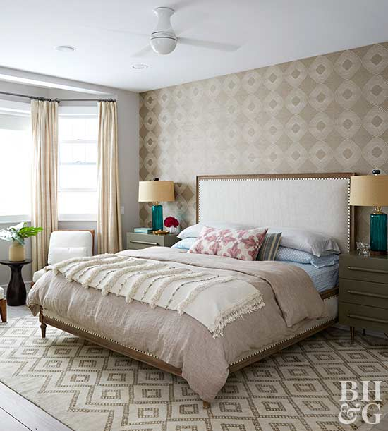 neutral bedroom with upholstered headboard