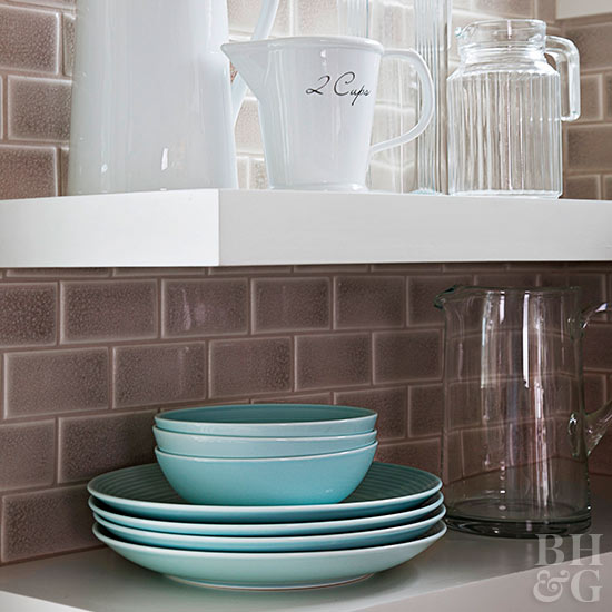 Dishes on white kitchen shelves