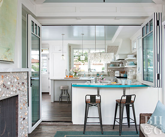 white kitchen with teal countertop