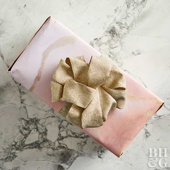 present wrapped with gold bow on top