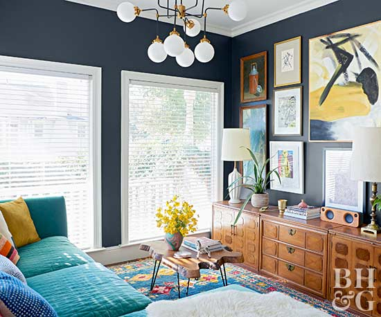 navy family room, teal couch, wall art