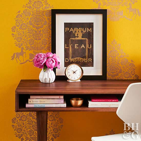 wooden desk with yellow wallpaper and frame