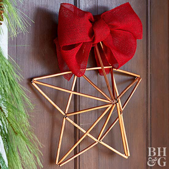 geometric copper pipe star with red bow